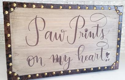 "Top of dog memorial box with ""Paw prints on my heart"" quote written in modern calligraphy."