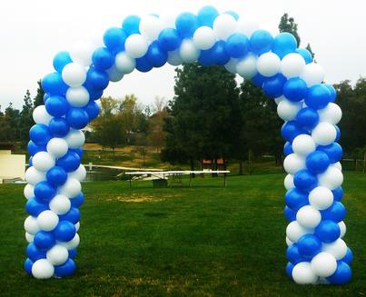 blue and white graduation balloon arch