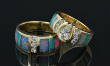 Hileman Australian opal wedding ring set in 14k gold with white sapphires.