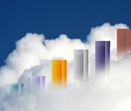 Representation of a sales bar graph with the multicolored result bars high enough to peak through the clouds, noting the rise in the housing market, which is closely studied by Marlene Letourneau Sales Representative in Belleville, ON