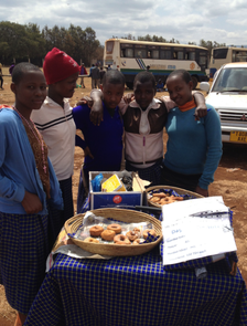 Students at the Dageno Girls Center selling wares.