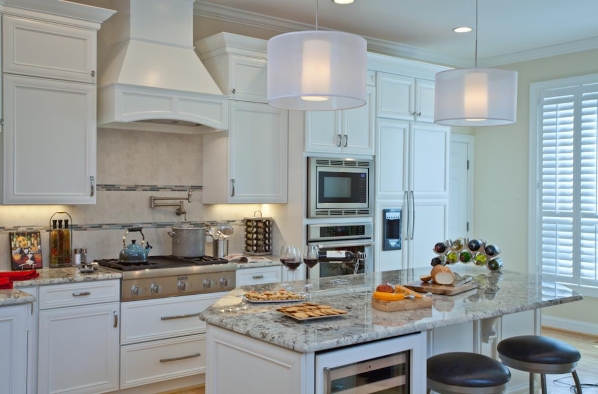 Beautiful white kitchen cabinets and appliance panels are just some elements of this beautiful kitchen remodel