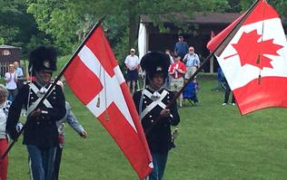 Danish guards carrying Danish & Canadian flags