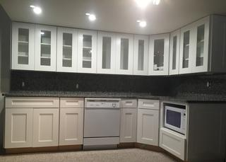 New Caledonia Granite kitchen countertop with full height back splash and eased edge. Cheap kitchen counter tops made to look expensive.