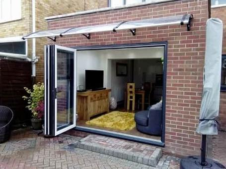 Folding Patio Doors with Woodgrain finish and Canopy