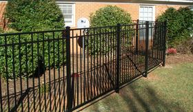 Black Vinyl Fence Professionally Installed by Dogwood Landscaping
