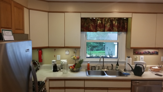 Mismatched cabinets were installed in order to house the microwave
