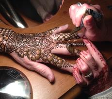 Jeanette applying Indo-Arabic bridal henna