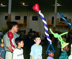 Colorful Balloon hats created by Balloon Artists - fun for kids of all ages at company picnics, birthday parties, corporate events.