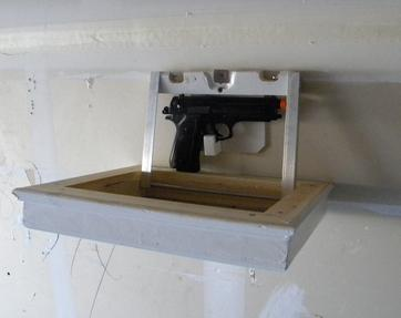 Secret hidden compartment Picture Frame Gun Safe. Frame folds down to reveal hidden hand gun. www.DIYeasycrafts.com