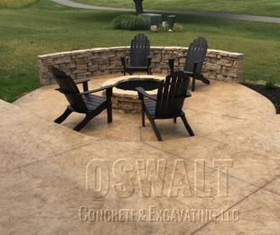 Seamless Italian Slate stamped concrete patio in wheat integral color with mojave antique featuring Belvedere paver sitting wall and fire pit