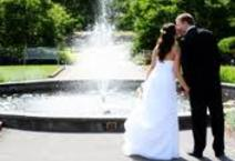 A wedding day kiss at an outdoor Lake Harriet wedding