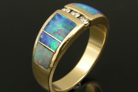 Opal inlay ring with damaged opal and non-matching end opal.