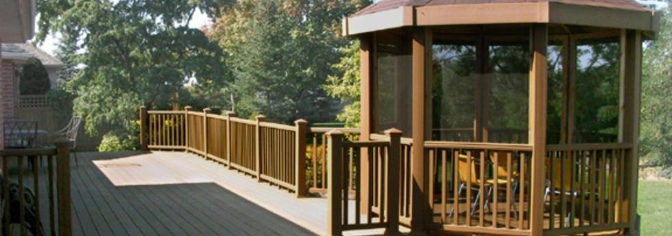 Multi-level deck with rails and built-in bench seating.