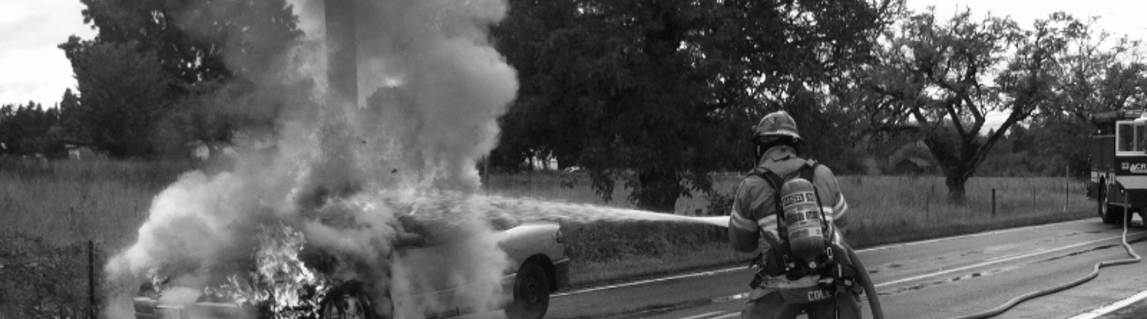Fireman putting out a car fire