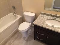 This bathroom development was completed as part of a new basement development in Stonebridge. Features include a custom vanity with granite counter-top, two tone ceramic tile, and in-floor electric heat complete with a programmable digital thermostat.