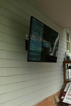 flat screen plasma lcd tv mounted with full motion mount on outdoor deck in charlotte nc,