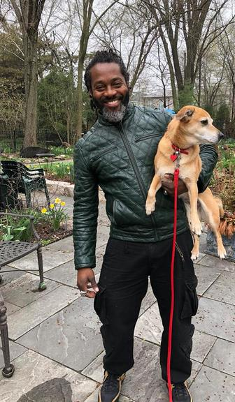 Toriano Sanzone Posing with a Dog