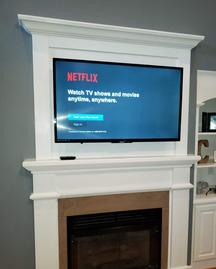 Custom Fireplace Cover up, TV mounted over fireplace niche by Carolina Custom Mounts in Charlotte and Fort Mill SC