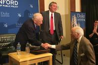 Abe Piasek, a Holocaust survivor from Poland, shaking Ben Ferencz's hand.