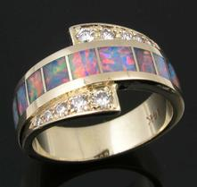Hileman opal ring repaired to new condition.