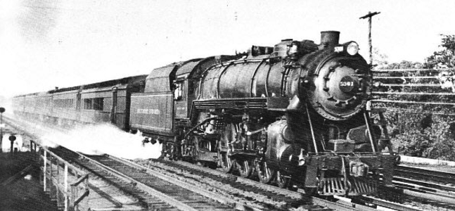 The speeding Marylander's 4-6-2 President-class Pacific steam locomotive, getting water from a track pan in New Jersey.