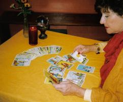 Fortune Teller at a Corporate Event performing a tarot card reading.