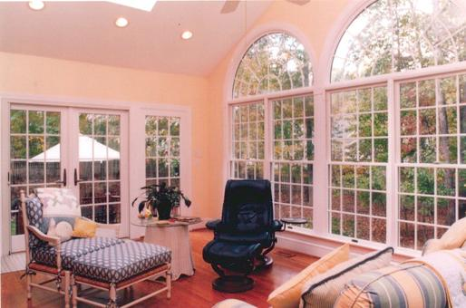 Interior view of sunroom with palladium windows.