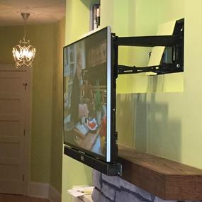Down and Out fireplace TV mount, easily pulls down over fireplace mantle to a more comfortable viewing height, Charlotte NC 4k ultra hd tv over fireplace mounting service