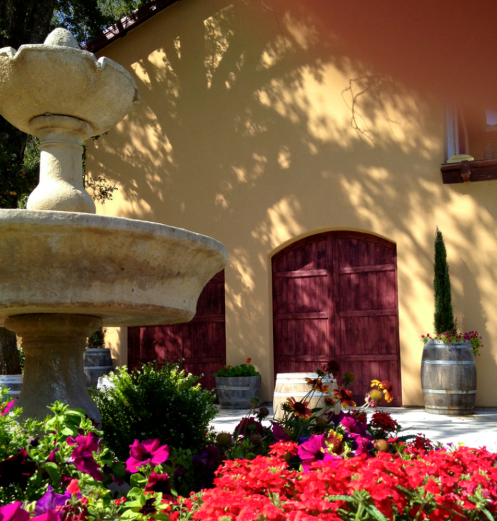 Fountain and flowers in front of the winery