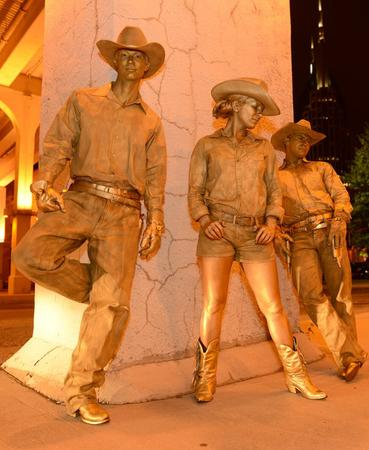 Gold Cowboy Living Statues at a Nashville company themed event.