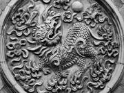 Traditional Tai Chi's Chinese dragon medallion.
