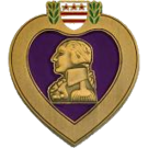 The Purple Heart City emblem, with a purple heart and a gold profiled view of George Washington inside it.