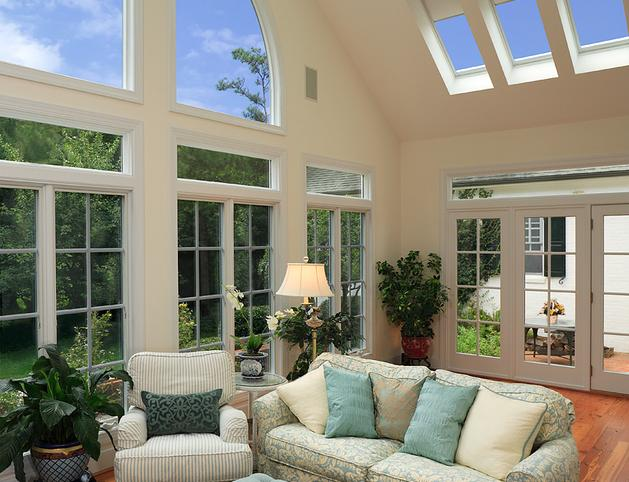 Beautiful sunroom with heart pine floors, skylights, french doors and entertainment center