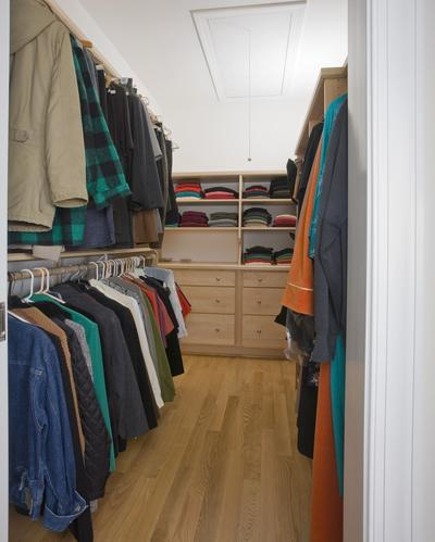 Owner's bedroom closet complete with custom closet system