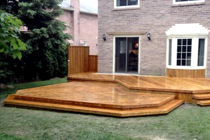 Custom built multi-level deck with planters.