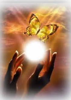 Photo image of two hands releasing a beautiful ball of white light from which a yellow butterfly emerges,
