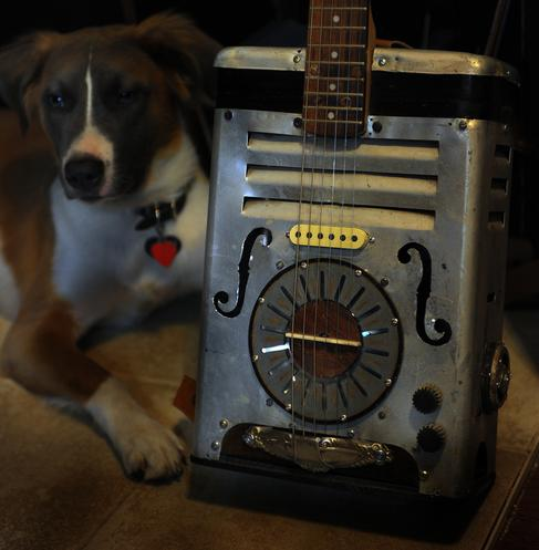 Cantar Cigar Box or Oil Can type of Guitar made by Postal Guitars
