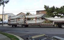 picture of a truckload of new boats for sale