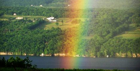 "alt=""Seneca Lake and Hillsides with bright rainbow"""