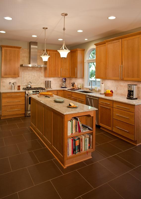 A large L-shaped island in the kitchen provides extra storage