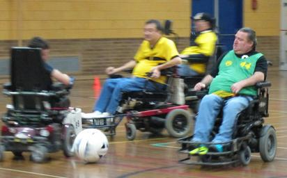 Photo of 4 people playing in a game of power soccer
