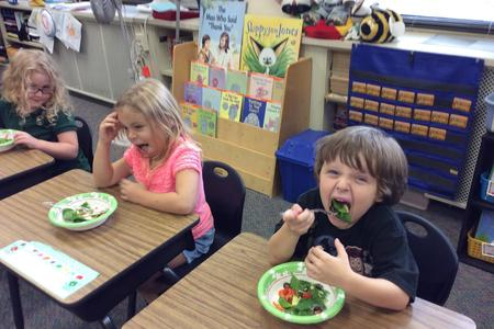 students eating salads