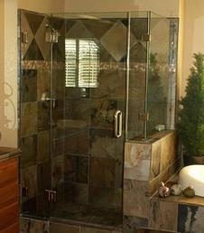 Frameless shower door and panel with half wall panel