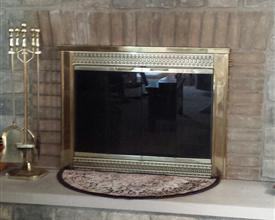 Photo of fireplace with glass doors at my childhood home