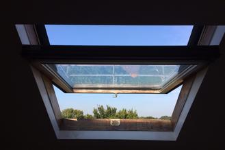 velux roto roof window skylight repair service maintenance installers specialist blind in London centre pivot top hung glass