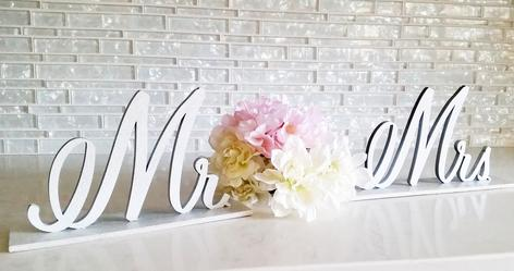 Mr. and Mrs. calligraphed and laser cut wood sign made for the wedding sweetheart table which can later be used as beautiful home decor.
