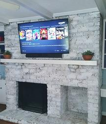 After picture of TV Mounted on Brick Fireplace with components installed.  Carolina Custom Mounts in Charlotte nc. Best TV Mounting Service