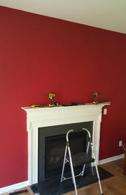 before Carolina Custom Mounts installed flat screen tv over fireplace with floating glass shelf below, flat screen tv mounting service