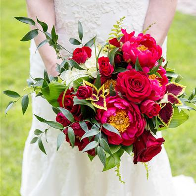 bridal bouquet being held in front of bride